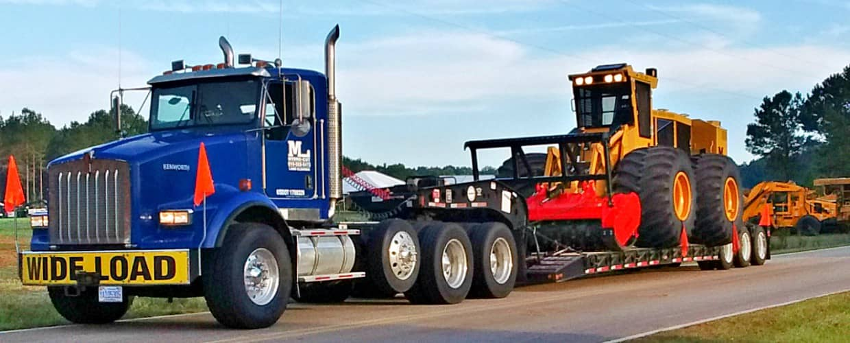 Truck Towing Tigercat Equipment
